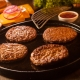 four hamburger patties